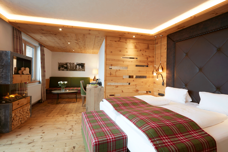 Suite Traumblick Bett im Wellnesshotel Alpbacherhof in Tirol