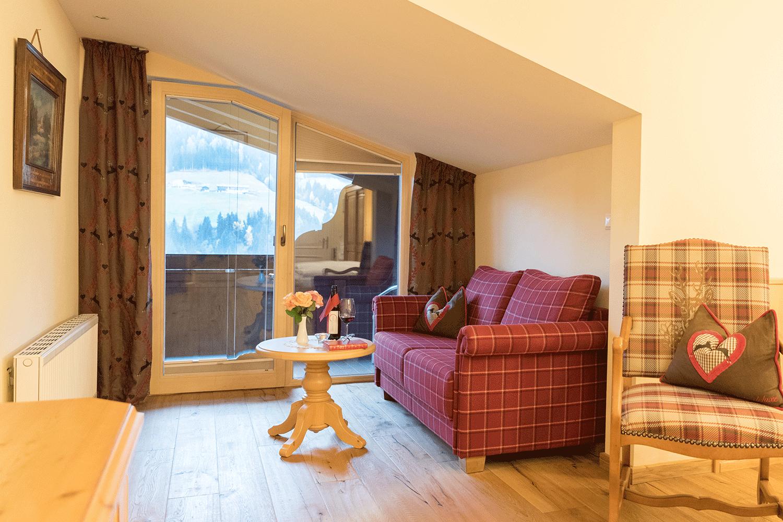 Wohnkomfortzimmer Panorama Junior Sitzecke im Wellnesshotel Alpbacherhof in Tirol